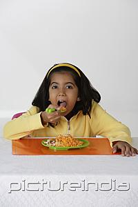 PictureIndia - Girl eating briyani rice