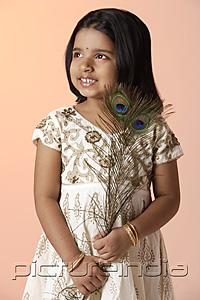 PictureIndia - Little girl wearing traditional Indian clothing holding peacock feathers