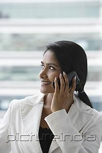 PictureIndia - profile of an Indian woman talking on phone and smiling.