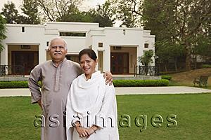 Asia Images Group - senior couple in front of home