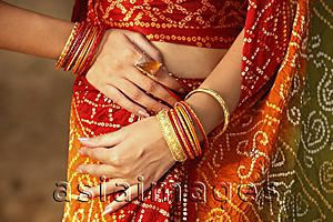 Asia Images Group - arms of woman wearing bangles
