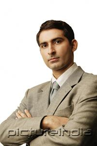 PictureIndia - Businessman, looking at camera, arms crossed