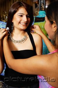 PictureIndia - Women adjusting necklace for her friend