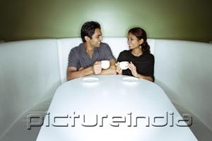 PictureIndia - Couple sitting side by side having tea