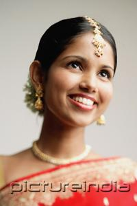 PictureIndia - Portrait of woman in Indian sari, smiling